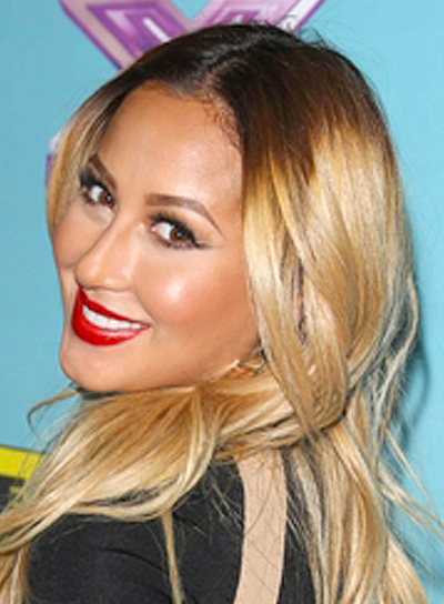 Adrienne Bailon's Long, Tousled, Wavy, Blonde, Hairstyle