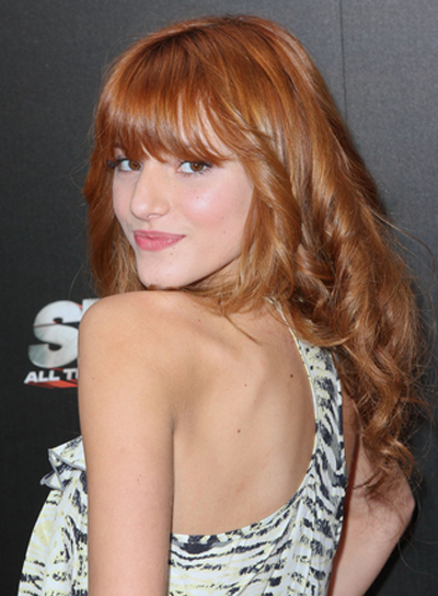 Bella Thorne Long, Curly, Red Hairstyle with Bangs