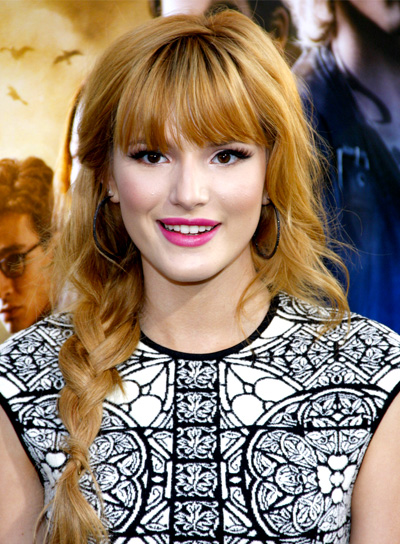 Bella Thorne's Long, Romantic, Wavy, Red Hairstyle with Braids and Bangs
