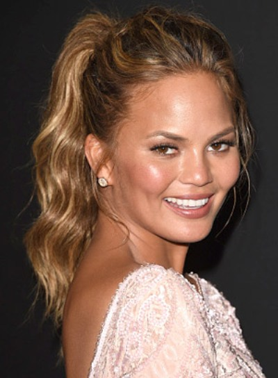 Chrissy Teigen with a Tousled, Wavy, Sexy, Ponytail Hairstyle Pictures