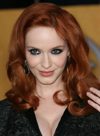 Christina Hendricks' Medium, Curly, Romantic, Red Hairstyle