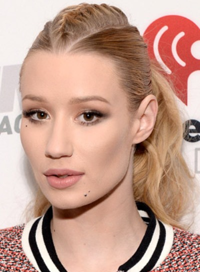 Iggy Azalea with a Blonde, Funky, Ponytail Hairstyle with Braids and Twists Pictures