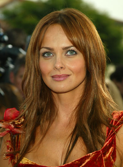 Izabella Scorupco Long, Layered Hairstyle