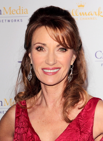 Jane Seymour Medium, Curly, Sophisticated, Brunette Half Updo with Bangs