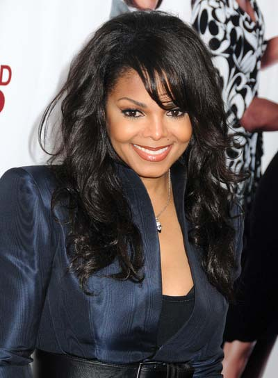Janet Jackson Black Curly Hairstyle With Bangs