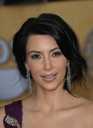 Kim Kardashian Tousled, Wavy, Sophisticated Updo