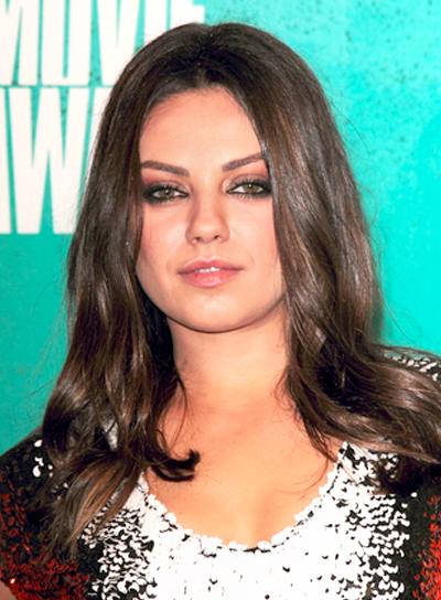 Mila Kunis' Medium, Tousled, Brunette, Wavy Hairstyle