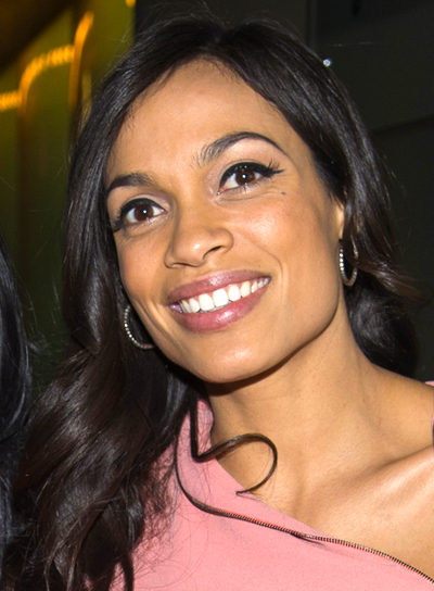Rosario Dawson's Medium, Black, Wavy, Tousled Hairstyle