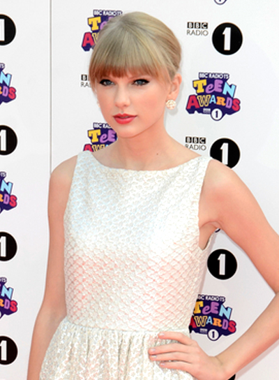 Taylor Swift's Chic, Blonde, Sophisticated, Updo Hairstyle with Bangs