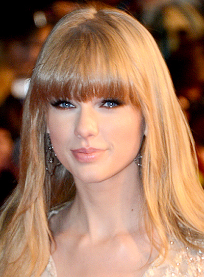 Taylor Swift's Long, Straight, Blonde Hairstyle with Bangs