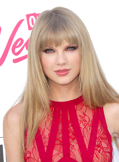 Taylor Swift's Long, Straight, Chic Hairstyle with Bangs